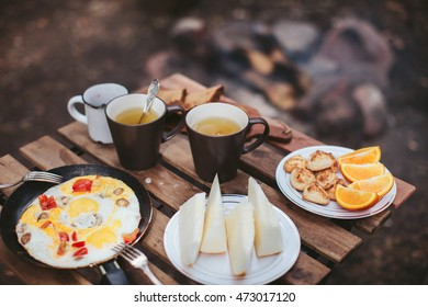 Breakfast in nature, scrambled eggs with melon