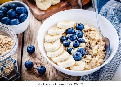 Breakfast: oatmeal with bananas, blueberries, chia seeds and almonds. Selective focus