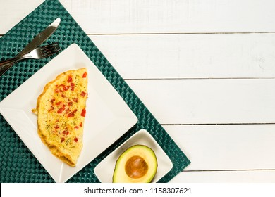 Breakfast, omelet with tomato and avocado