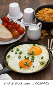 breakfast on brown wooden background