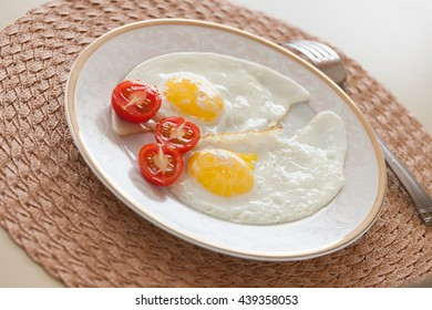 Breakfast on the table, fried eggs.