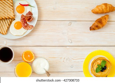 Breakfast on a white wooden background