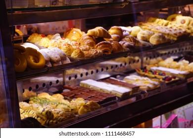 Breakfast pastries in a bakery window, Venice, Italy