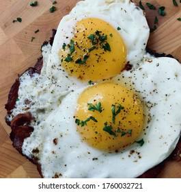 Breakfast Pizza; Sunnyside Up Eggs on top of Bacon Crust