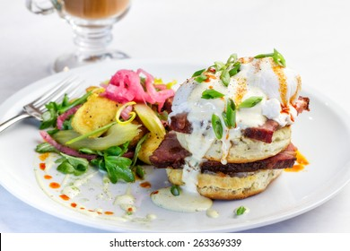 A breakfast plate of Eggs Benedict with Tasso