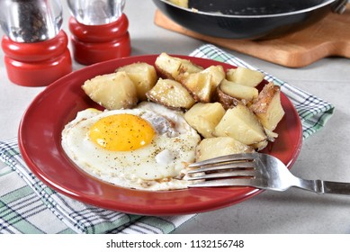 Breakfast plate of fried egg and potatoes