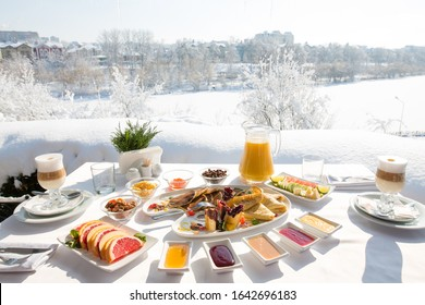 Breakfast at the restaurant in the snowy winter outdoors