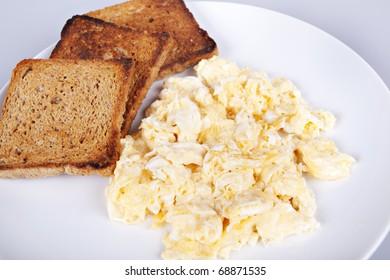 Breakfast - roasted toasts, eggs, bacon
