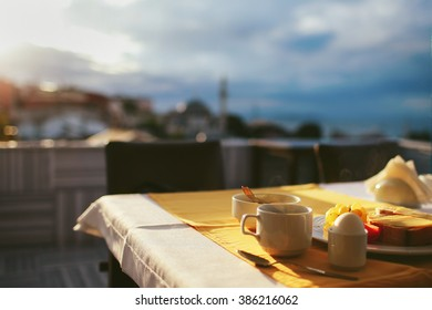 Breakfast at the rooftop cafe with views of the sunrise in Istanbul
