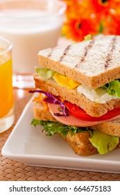 Breakfast sandwich ham and tomato