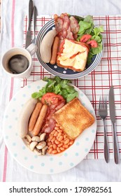 Breakfast with sausages, baked bean, mushroom and bacon