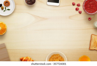Breakfast scene with free space, tablecloth, fruits, toast, jar of jam, phone, cutting board on table. Top view.