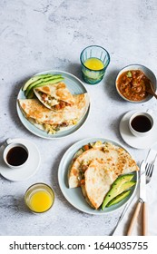 Breakfast: Scrambled eggs quesadillas served with roasted tomatoes sauce, avocado slices,.