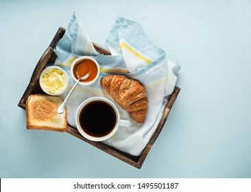 Breakfast served with coffee, croissant, bread, jam and butter. Continental delicious healthy breakfast