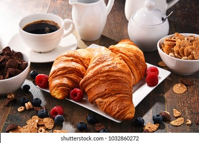 Breakfast served with coffee, croissants, cereals and fruits. Balanced diet.
