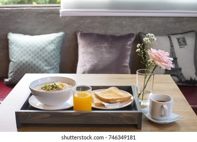 Breakfast served with coffee, orange juice, boiled rice