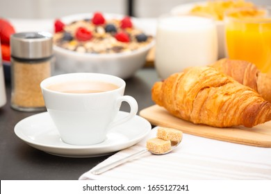 Breakfast Served in the morning with Hot black coffee and croissants Natural corn flake breakfast cereal in cups and fruit on the breakfast table every day