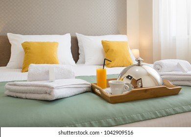 Breakfast served on a hotel bed