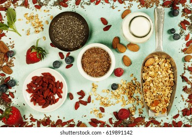 Breakfast set with granola, almond milk, superfoods and berries. Morning food, Diet, Detox, Clean Eating, Vegetarian concept.