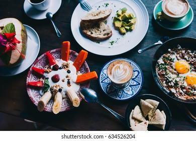 Breakfast: shashuka fried eggs, avocado on toast, fresh fruits with yogurt and granola, coffee black, cappuccino, latte, coconut