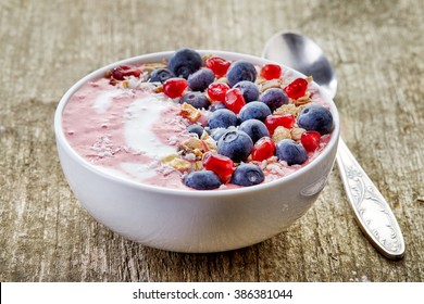 breakfast smoothie bowl on wooden table