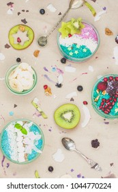 Breakfast smoothie bowls and chia pudding topped with fresh fruits