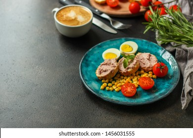 Breakfast snack, tasty food (pate, toast, tomato, corn, egg, coffee). top view. food background