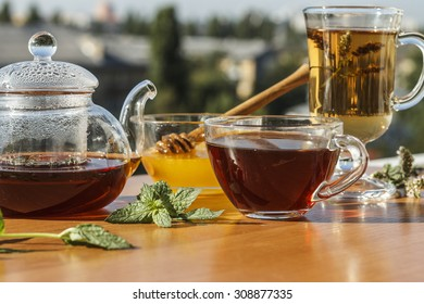 Breakfast, Spearmint, Peppermint. TEA. black tea in glass teapot and cup with honey and mint