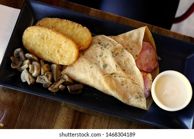 Breakfast Style Crepe with Hash Browns and Mushrooms