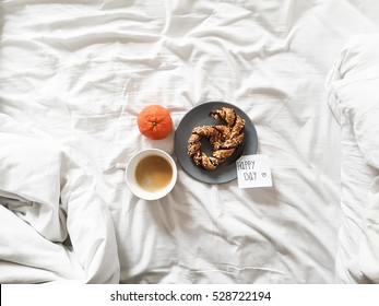 breakfast sweet, mandarine, coffee and note over bed