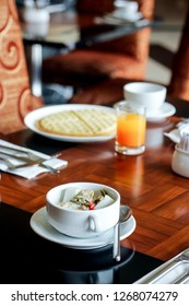 Breakfast Table with a Bowl of Lontong Sayur or Ketupat Sayur, an Indonesian Traditional Food