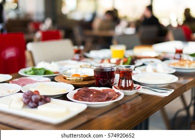 Breakfast table with cheese, eggs, tea, salad, grapes, menemen, olives, walnut. Rich breakfast concept. Traditional Turkish Breakfast.
