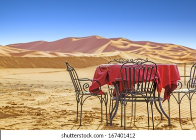 Breakfast table in front of sand dunes