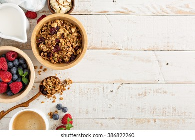 Breakfast table with granola, coffee and fresh berries