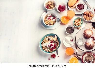 Breakfast table. Healthy breakfast ingredients. Top view with copy space