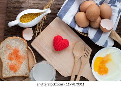 breakfast table with heart shape sign on wooden cutting board. concept of healthy food eating. top view kitchen table.