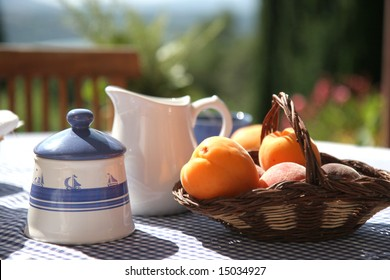 breakfast table on sunny terrace, french Riviera
