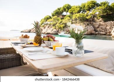 breakfast table onboard a luxurious motor yacht