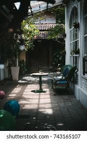 Breakfast table in patch of sunlight