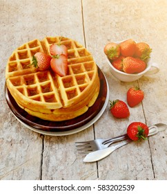 breakfast table, strawberry waffles on wooden table, selective focus  with lens flare