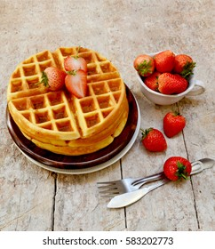 breakfast table, strawberry waffles on wooden table, selective focus