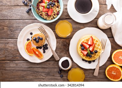 Breakfast table with waffles, granola and fresh berries - Shutterstock ID 342814394