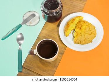 Breakfast with tea corn cake and raspberry jam