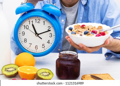breakfast time, alarm clock and healthy and balanced breakfast