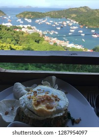 Breakfast time with panoramic view of ships in Labuan Bajo beach, Flores Indonesia