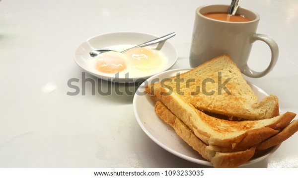 breakfast toast with soft boil eggs set, a typical breakfast choice in singapore