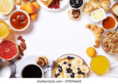 breakfast with toasts, fruits, jam, coffee and buns. top view. place for text