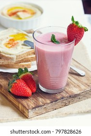 Breakfast toasts with hummus and strawberry banana smoothie