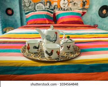 Breakfast tray with vintage  crockery in a colorful retro bedroom.