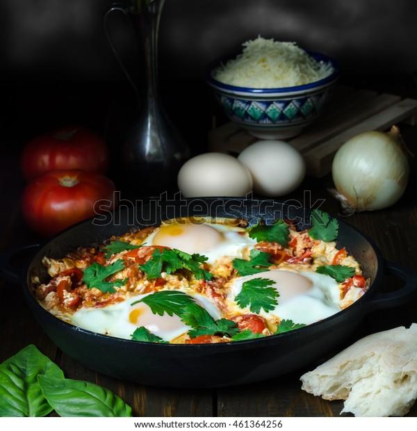 Breakfast with Turkish spicy shakshuka, still life